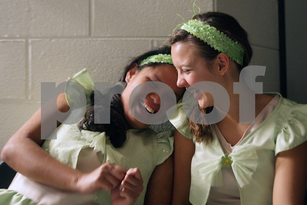 """Rob Winner – rwinner@shawmedia.com<br /> <br /> Stephannie Baccay (left), 17, and Lindsay Cooper, 16, both playing Triton's daughters, share a laugh backstage during rehearsal for the Penguin Project's performance of Disney's """"The Little Mermaid Jr"""" at Sycamore High School on Monday, Sept. 23, 2013."""