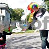 Monica Maschak - mmaschak@shawmedia.com<br /> Junior Jake Wieseler, dressed as a clown, hands out a balloon hat to Julie Mucha, 3, during the Indian Creek Homecoming Parade in Waterman on Saturday, September 28, 2013.