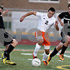 Monica Maschak - mmaschak@shawmedia.com<br /> Dylan Hottsmith finds himself betweem two spartans in the first half of the Sycamore soccer match at DeKalb High School on Tuesday, September 24, 2013. DeKalb won 7-0.