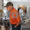 Rob Winner – rwinner@shawmedia.com<br /> <br /> Sycamore resident Bob Stanbery looks over items that once belonged to the late Barbara (Groves) Wallin and Carl Wallin during an estate sale on Thursday morning in Sycamore.<br /> <br /> Thursday, Sept. 26, 2013