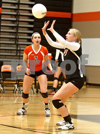Monica Maschak - mmaschak@shawmedia.com<br /> Abby Hickey sets a returned ball in the first of two sets against Yorkville on Thursday, September 26, 2013. DeKalb won both sets.