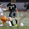 Monica Maschak - mmaschak@shawmedia.com<br /> DeKalb's Logan Brown and Sycamore's Jarrett Brown battle for direction of the ball in the first half of the Sycamore soccer match at DeKalb High School on Tuesday, September 24, 2013. DeKalb won 7-0.