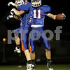 Monica Maschak - mmaschak@shawmedia.com<br /> Running backs Eli Thurlby and Tyeler L'Huillier jump in celebration of L'Huillier's touchdown in the first quarter against Burlington Central on Friday, September 27, 2013.