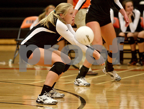 Monica Maschak - mmaschak@shawmedia.com<br /> Abby Hickey digs a serve in the second of two sets against Yorkville on Thursday, September 26, 2013. DeKalb won both sets.