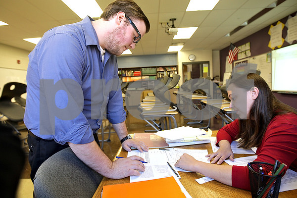 Monica Maschak - mmaschak@shawmedia.com<br /> Eighth grade english and literature teacher Jenny Tekiela (left) and student teacher Jacob Keene debrief after school and discuss lesson plans at Sycamore Middle School on Friday, September 27, 2013. Keene is a senior English student at Northern Illinois University who wishes to get his teaching license and have his own classroom after graduation.