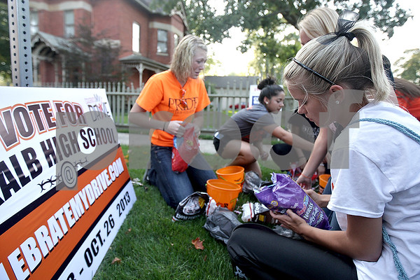 Monica Maschak - mmaschak@shawmedia.com<br /> Members of Celebrate My Drive fill buckets with candy prior to the DeKalb Homecoming parade on Thursday, September 19, 2013. The student group promotes and encourages students to be safe drivers.
