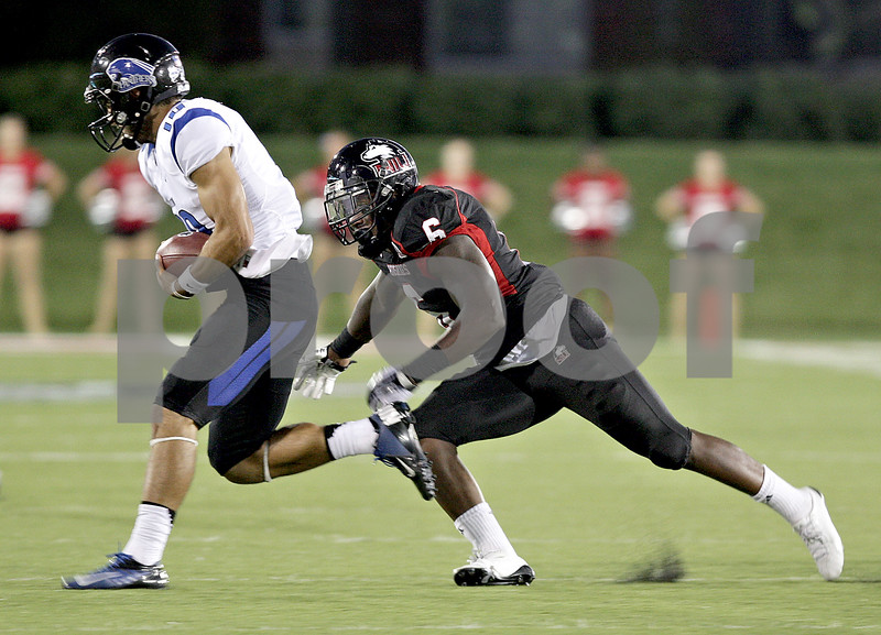 Monica Maschak - mmaschak@shawmedia.com<br /> Linebacker Jamaal Bass catches the Panther quarterback for a successful sack in the second quarter of Northern Illinois hosting Eastern Illinois on Saturday, September 21, 2013. The Huskies won 43-39.
