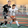 Monica Maschak - mmaschak@shawmedia.com<br /> DeKalb's Sean Woodford makes a pass before Sycamore's Tyler Maveus could pressure him in the first half of the Sycamore soccer match at DeKalb High School on Tuesday, September 24, 2013. DeKalb won 7-0.
