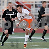 Monica Maschak - mmaschak@shawmedia.com<br /> Dylan Hottsmith passes to an open teammate in the first half of the Sycamore soccer match at DeKalb High School on Tuesday, September 24, 2013. DeKalb won 7-0.