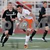 Monica Maschak - mmaschak@shawmedia.com<br /> Dylan Hottsmith passes to an open teammate in the first half of the Sycamore soccer match at DeKalb High School on Tuesday, September 24, 2013. DeKalb won 7-0.
