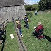 Jeff Krage – For Shaw Media<br /> Ed Simon, left, informs visitors about oxen during Sunday's Harvest Days at Garfield Farm Museum.<br /> Campton Hills 10/6/13