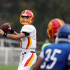 Jeff Krage – For Shaw Media<br /> Batavia quarterback Micah Coffey looks for his tightend Noah Frazier during Saturday's game against Larkin at Memorial Stadium in Elgin.<br /> Elgin 10/5/13