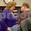 Monica Maschak - mmaschak@shawmedia.com<br /> Patricia Schmidt shares a moment of relief with her husband, Jeff Schmidt, after a judge ruled her not guilty on all four counts at the DeKalb County Courthouse on Thursday, April 3, 2014.