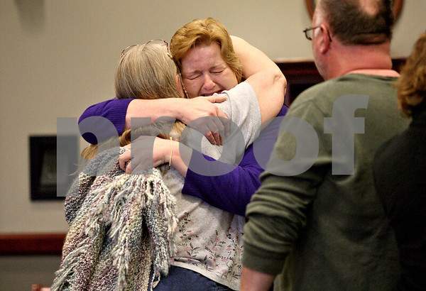 Monica Maschak - mmaschak@shawmedia.com<br /> Patricia Schmidt hugs a family member after a judge ruled her not guilty on all four counts at the DeKalb County Courthouse on Thursday, April 3, 2014.