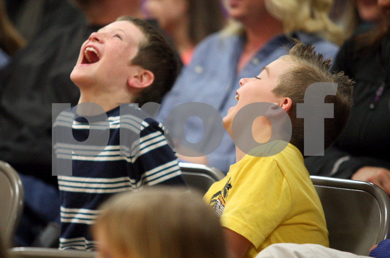 Monica Maschak - mmaschak@shawmedia.com<br /> Davenport Elementary School first graders Noah Tatroe (left) and Talon Joynt laugh during the family Pro-Kids Show at Kingston Elementary School on Wednesday, April 23, 2014. The show included magic, music, puppets and comedy, as well as character education and anti-bullying messages.