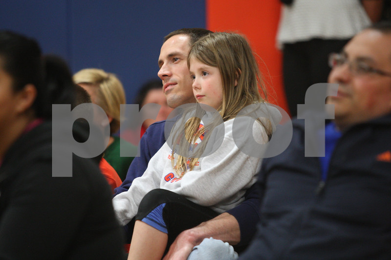 Monica Maschak - mmaschak@shawmedia.com<br /> Kingston Elementary School third grader Allison Haag and her father, Bryan Haag, watch the Pro-Kids Show at Kingston Elementary School on Wednesday, April 23, 2014. The show included magic, music, puppets and comedy, as well as character education and anti-bullying messages.