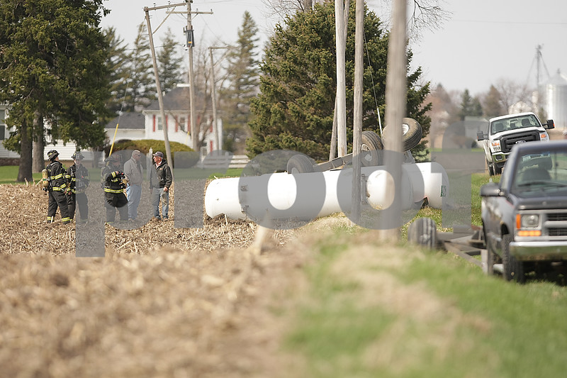 Danielle Guerra - dguerra@shawmedia.com  Genoa-Kingston firefighters stand by the two tanks of anhydrous ammonia on the side of Route 23 outside Genoa on Tuesday April 22, 2014. Authorities expect Route 23 will be closed north of Genoa until at least 5 p.m. as they clean up a leaking anhydrous ammonia tank involved in a crash about 2:45 p.m. today.