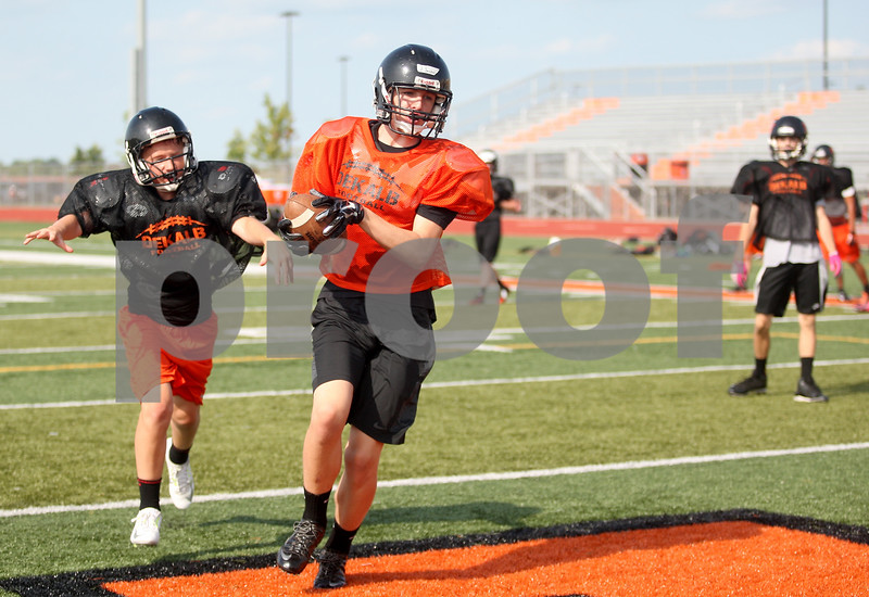 Monica Maschak - mmaschak@shawmedia.com<br /> DeKalb works on passing and catching during practice on Friday, August 15, 2014.