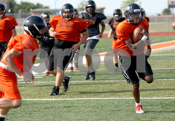 Monica Maschak - mmaschak@shawmedia.com<br /> DeKalb works on their running plays during practice on Friday, August 15, 2014.