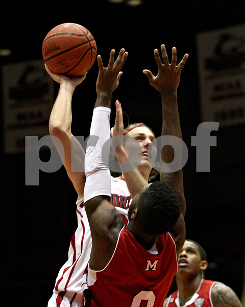 Monica Maschak - mmaschak@shawmedia.com<br /> Northern Illinois' Aksel Bolin shoots the ball in the first half against Miami on Tuesday, February 4, 2014. The Huskies won, 53-41.
