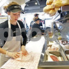Monica Maschak - mmaschak@shawmedia.com<br /> Karlie Becker wraps a sandwich for a customer at Jimmy John's Gourmet Sandwiches in DeKalb on Monday, February 3, 2014.