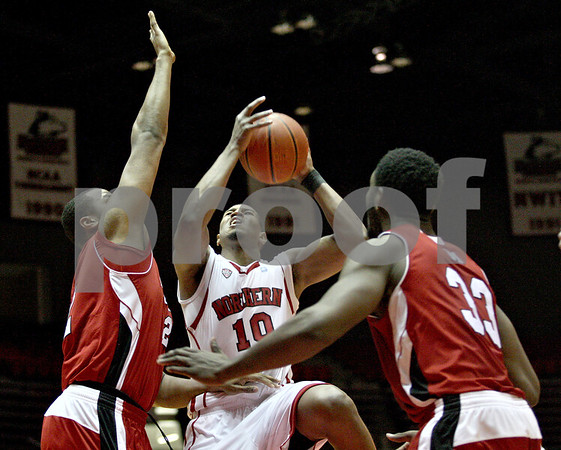 Monica Maschak - mmaschak@shawmedia.com<br /> Northern Illinois' Darrell Bowie attempts two points in the second half against Miami on Tuesday, February 4, 2014. The Huskies won, 53-41.