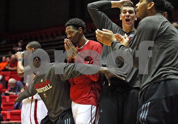 Monica Maschak - mmaschak@shawmedia.com<br /> Northern Illinois' basketball team reacts to gaining a lead in the second half against Miami on Tuesday, February 4, 2014. The Huskies won, 53-41.