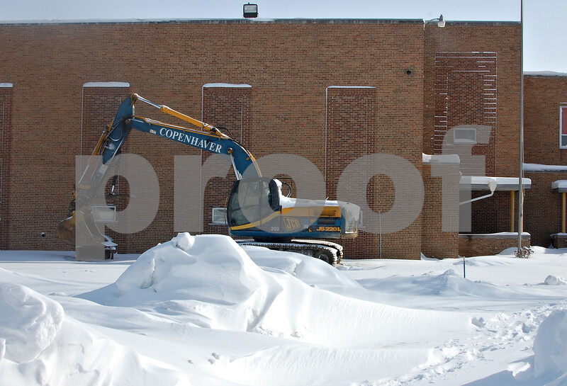 Debbie Behrends - dbehrends@shawmedia.com<br /> A piece of construction equipment sits near the oldest portion of HIawatha Elementary School on Wednesday, Feb. 5. School Superintendent Sarah Willey said renovation of the building would have cost significantly more than new construction.