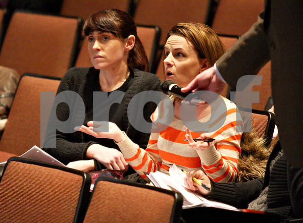 Monica Maschak - mmaschak@shawmedia.com<br /> Lisa Williams, of Cortland, states her feelings during a presentation on the indoor air quality investigation of Cortland Elementary School at DeKalb High School on Thursday, February 6, 2014. Williams has three children who attend Cortland Elementary School.