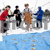 "Monica Maschak - mmaschak@shawmedia.com<br /> Gavin Gartman (left), 13, and Allan Wedeman, 14, from Boy Scout Troop 13 from DeKalb fish for ""snappers"" at the annual Klondike Derby at the Sycamore Sportsman's Club on Saturday, February 1, 2014."