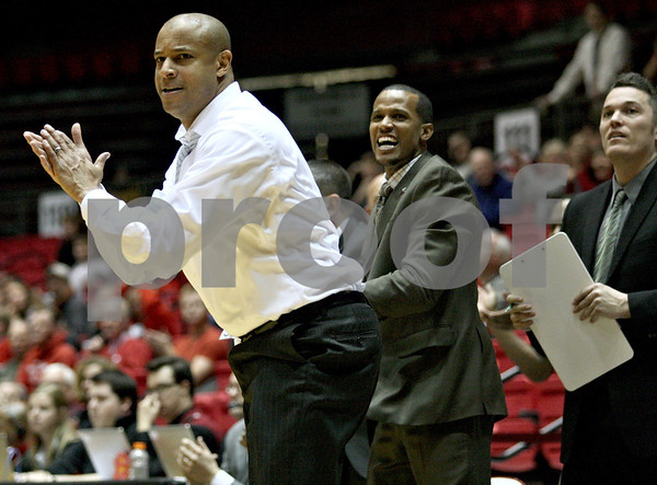 Monica Maschak - mmaschak@shawmedia.com<br /> Northern Illinois Coach Mark Montgomery cheers on his team in the second half against Miami on Tuesday, February 4, 2014. The Huskies won, 53-41.