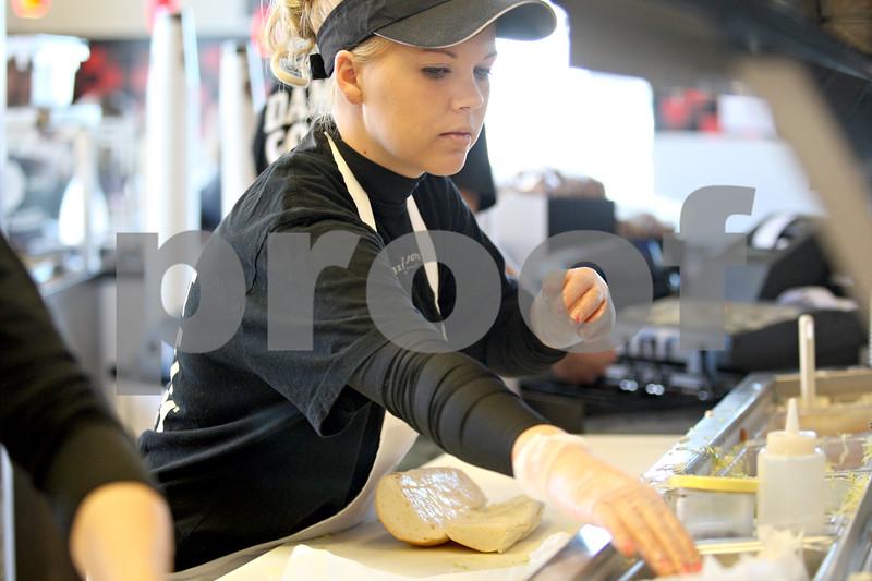 Monica Maschak - mmaschak@shawmedia.com<br /> Ashley Rohdes prepares a sandwich at Jimmy John's Gourmet Sandwiches in DeKalb on Monday, February 3, 2014.