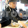 Monica Maschak - mmaschak@shawmedia.com<br /> Ashley Rohdes prepares a sandwich at Jimmy John's Gourmet Sandwiches in DeKalb on Monday, February 3, 2014.