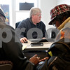 Monica Maschak - mmaschak@shawmedia.com<br /> Manager Dale Fluegel helps customers with their taxes at Liberty Tax Services in DeKalb.