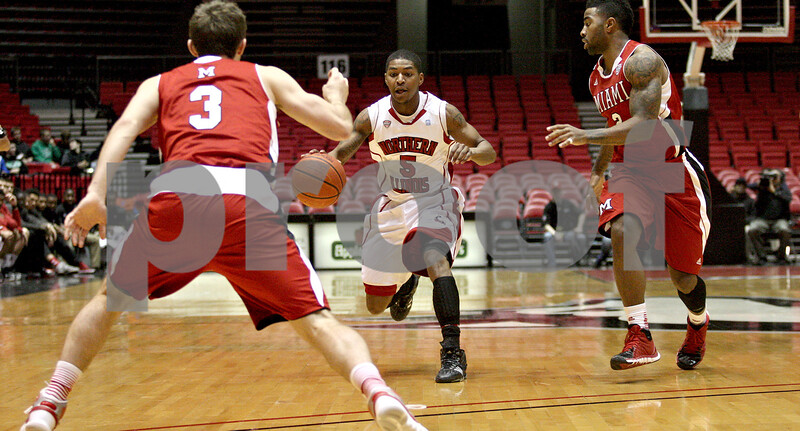 Monica Maschak - mmaschak@shawmedia.com<br /> Northern Illinois' Travon Baker dribbles down the court in the first half against Miami on Tuesday, February 4, 2014. The Huskies won, 53-41.