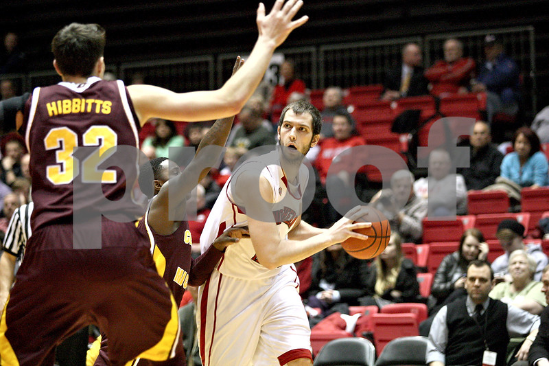 Monica Maschak - mmaschak@shawmedia.com<br /> Northern Illinois' Pete Rakocevic looks for an open teammate in the first half against Central Michigan on Wednesday, February 12, 2014. The Huskies won, 88-63.