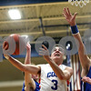 Monica Maschak - mmaschak@shawmedia.com<br /> Genoa-Kingston's Tommy Lucca attempts a field goal in the second quarter against Burlington Central on Friday, February 7, 2014. The Cogs lost, 58-49.
