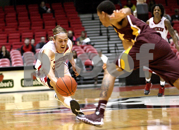 Monica Maschak - mmaschak@shawmedia.com<br /> Northern Illinois' Aksel Bolin dives for a loose ball in the first half against Central Michigan on Wednesday, February 12, 2014. The Huskies won, 88-63.