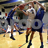 Monica Maschak - mmaschak@shawmedia.com<br /> Genoa-Kingston's Salvatore Lopez leaps for a shot in the third quarter against Burlington Central on Friday, February 7, 2014. The Cogs lost, 58-49.