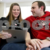 Monica Maschak - mmaschak@shawmedia.com<br /> Northern Illinois University graduate students Megan Kozenczak and Alex Pitner, both 24, browse Pinterest in their free time on campus on Wednesday, February 12, 2014. They will both graduate in May and get married on Dec. 19.