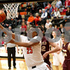 Monica Maschak - mmaschak@shawmedia.com<br /> DeKalb's Luke Davis takes the ball to the hoop in the third quarter against Morris on Friday, February 14, 2014. DeKalb lost, 47-50.