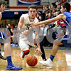 Monica Maschak - mmaschak@shawmedia.com<br /> Genoa-Kingston's Tommy Lucca takes it down the court in the first quarter against Burlington Central on Friday, February 7, 2014. The Cogs lost, 58-49.