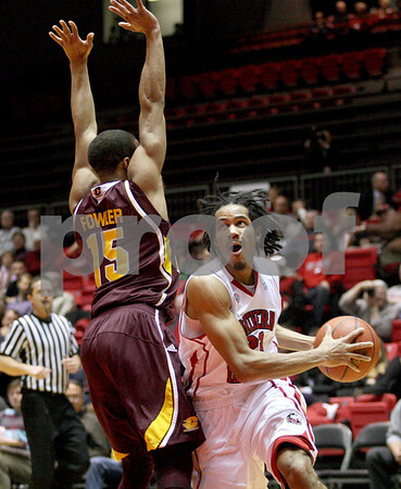 Monica Maschak - mmaschak@shawmedia.com<br /> Northern Illinois' Aaric Armstead goes in for a field goal attempt in the first half against Central Michigan on Wednesday, February 12, 2014. The Huskies won, 88-63.