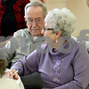Monica Maschak - mmaschak@shawmedia.com<br /> Sycamore resident Harry Wells puts his arm around his wife of 64 years, Shirley Wells, at a breakfast for couples married 50 years or longer at St. Mary's Memorial Hall in Sycamore on Thursday, February 13, 2014.