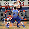 Monica Maschak - mmaschak@shawmedia.com<br /> Genoa-Kingston's Tommy Hansen sets up the play in the second quarter against Burlington Central on Friday, February 7, 2014. The Cogs lost, 58-49.