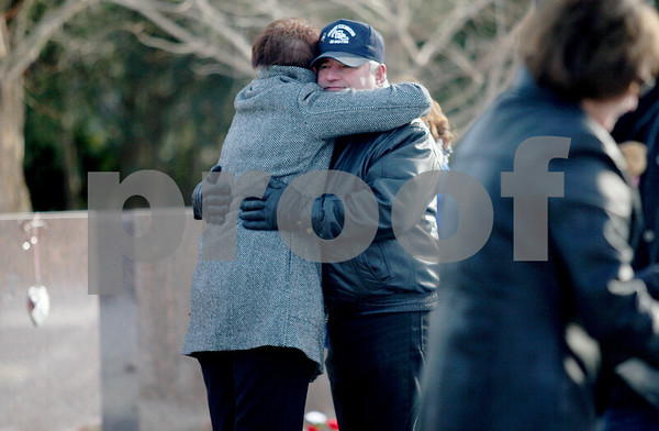 Monica Maschak - mmaschak@shawmedia.com<br /> Larry Gehant, uncle of victim Julianna Gehant, hugs Associate Vice President of Student Affairs Kelly Wesener-Michael during a moment of reflection on the sixth anniversary of the campus shooting at Northern Illinois University's Memorial Garden on Friday, February 14, 2014. Families, students and community members gathered for the ringing of five bells in honor of the five students who lost their lives.