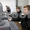 Monica Maschak - mmaschak@shawmedia.com<br /> Eight graders Ricky Ross Jr. (right) and Jack Sunderlage work on an in-class assignment in a computer lab at Hiawatha Middle School on Monday, February 10, 2014. Next year, students across Illinois will participate in PARCC testing via their school's computers.