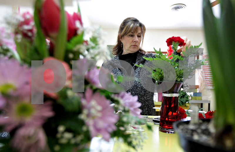Monica Maschak - mmaschak@shawmedia.com<br /> Floral designer Julie Brazeau pieces together a Valentine's Day arrangement at Kar-Fre Flowers in Sycamore on Monday, February 10, 2014.