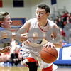 Monica Maschak - mmaschak@shawmedia.com<br /> Genoa-Kingston's Tommy Lucca runs into a block in the first quarter against Burlington Central on Friday, February 7, 2014. The Cogs lost, 58-49.