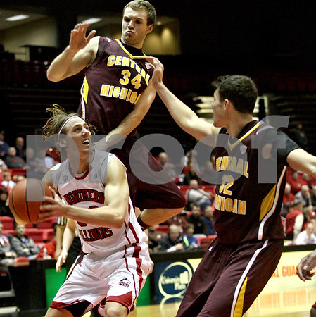Monica Maschak - mmaschak@shawmedia.com<br /> Northern Illinois' Aksel Bolin is surrounded by defenders in the second half against Central Michigan on Wednesday, February 12, 2014. The Huskies won, 88-63.
